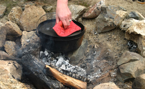 campfire cooking in a dutch oven