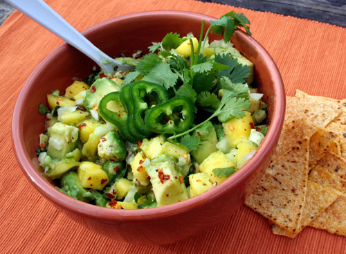 A heaping bowl of chunky mango guacamole best paired with tortilla chips.