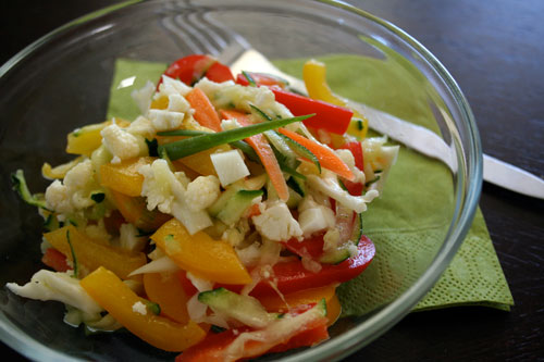 Summer vegetable zucchini slaw with red and yellow bell peppers.