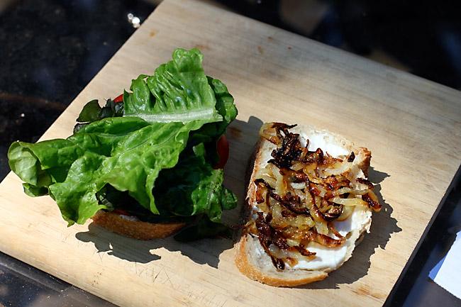 Assembling Caramelized Onion and Tomato Sandwich