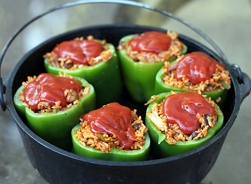 Dutch oven stuffed peppers dirty gourmet for Healthy dutch oven camping recipes