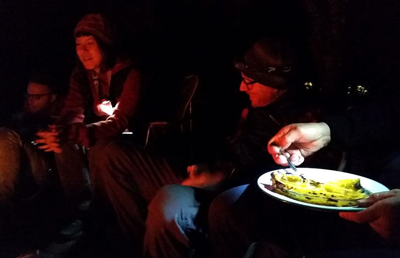 Friends around a campfire at Thanksgiving